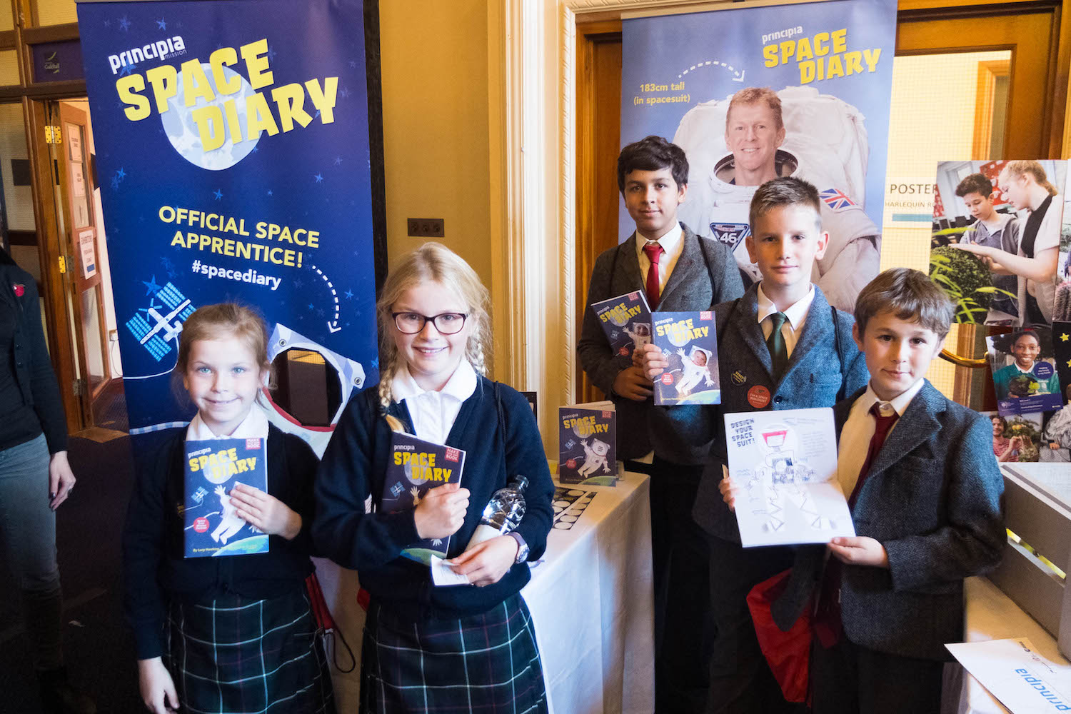 Four british school students hold their tim peake space diaries